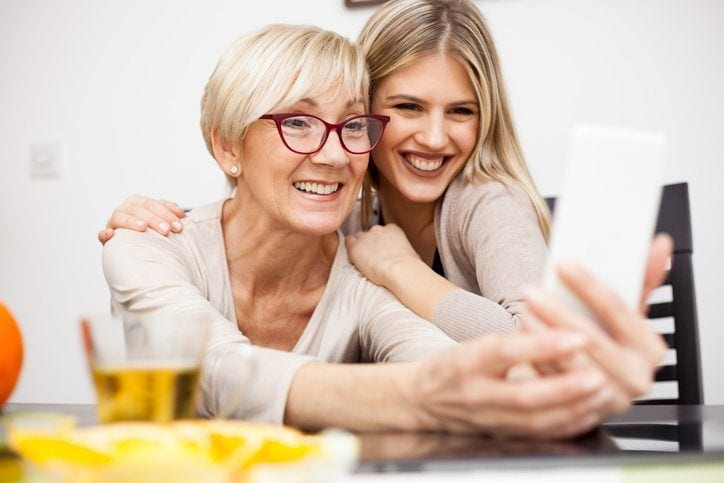 Mother and adult daughter taking selfie together- Adult Adoptions